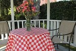 "#84RW  Red/white check 84"" round plastic tablecloth"